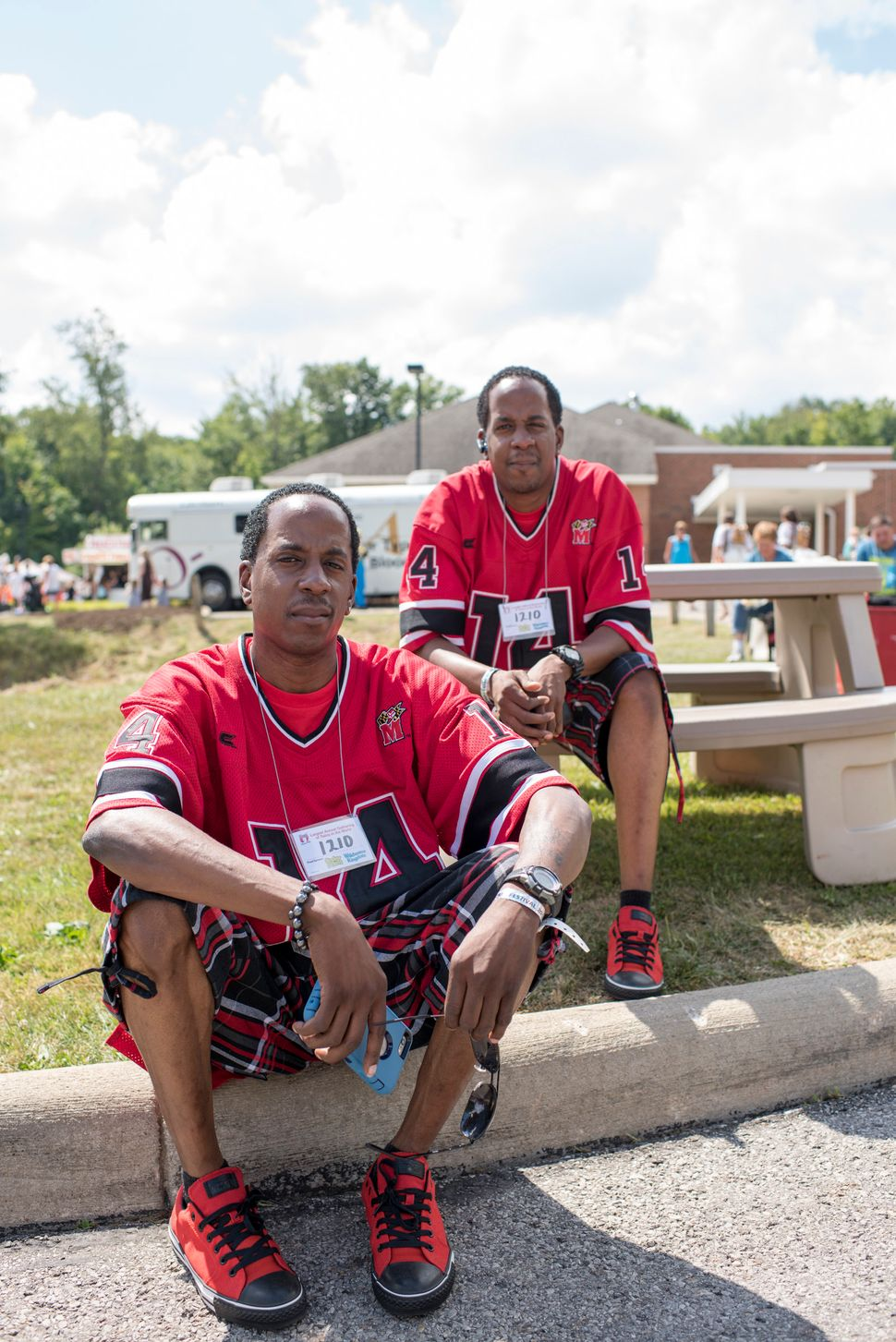 James and Charles Johnson, 33, are triplets but their sister, Denise, could not make it to the Twins Days Festival this year.