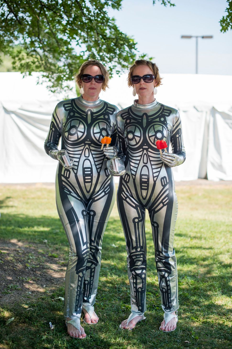 Heather and Tara Kelly, 42, pose dressed as robots during the Twins Days Festival. Heather is from Berkeley, California, whil