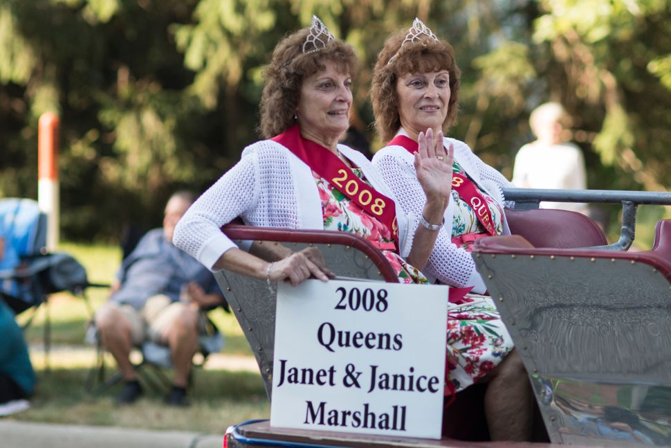 Former Festival Queens Janet and Janice Marshall make their way down the parade route during the Twins Days Festival.