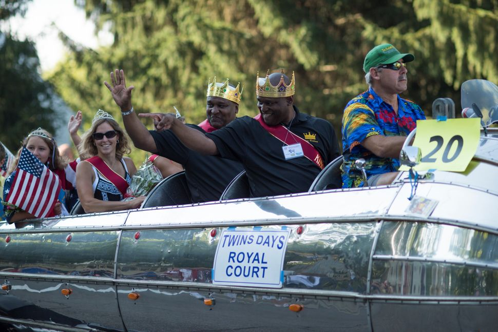 Festival Kings Richard and Robert Murphy ride the parade route during the festival.