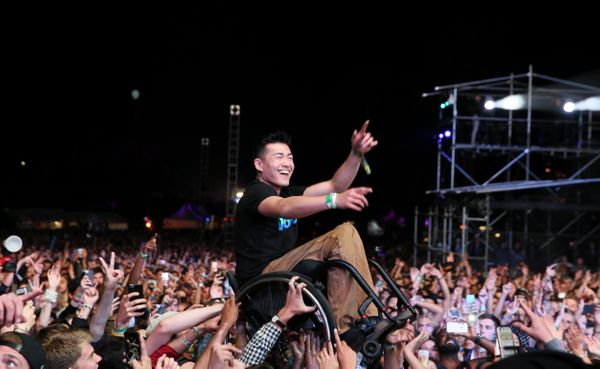 """<span style=""""color: #222222;""""><span style=""""color: #555555;"""">The fan, Ryan Chen, made his way toward Lamar as the artist spoke"""