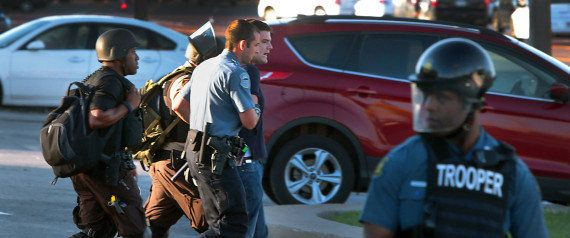Huffington Post reporter Ryan Reilly is taken away by police during the unrestin Ferguson, Missouri, in August201