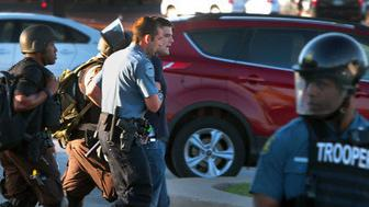 <p>Huffington Post reporter Ryan Reilly is taken away by police during the unrest&nbsp;in Ferguson, Missouri, in August last year.</p>