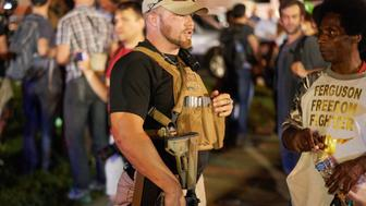 A member of the Oath Keepers walks with his personal weapon on the street during protests in Ferguson, Missouri on August 10, 2015. The Oath Keepers organization says its members  all former military, police and first responders  pledge to 'defend the Constitution against all enemies, foreign and domestic.'  The night ended with over 10 arrests for disorderly conduct. St. Louis County declared a state of emergency Monday following a night of unrest in Ferguson, after a teenager was charged with shooting at police officers. The order was issued as an 18-year-old was charged in connection with a shootout in Ferguson August 9th  after a day of peaceful protests marking the first anniversary of the police shooting of unarmed black teenager Michael Brown.      AFP PHOTO / MICHAEL B. THOMAS        (Photo credit should read Michael B. Thomas/AFP/Getty Images)