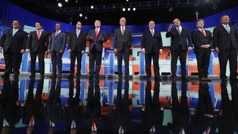 CLEVELAND, OH - AUGUST 06:  Republican presidential candidates (L-R) New Jersey Gov. Chris Christie, Sen. Marco Rubio (R-FL), Ben Carson, Wisconsin Gov. Scott Walker, Donald Trump, Jeb Bush, Mike Huckabee, Sen. Ted Cruz (R-TX), Sen. Rand Paul (R-KY) and John Kasich take the stage for the first prime-time presidential debate hosted by FOX News and Facebook at the Quicken Loans Arena August 6, 2015 in Cleveland, Ohio. The top-ten GOP candidates were selected to participate in the debate based on their rank in an average of the five most recent national political polls.  (Photo by Chip Somodevilla/Getty Images)