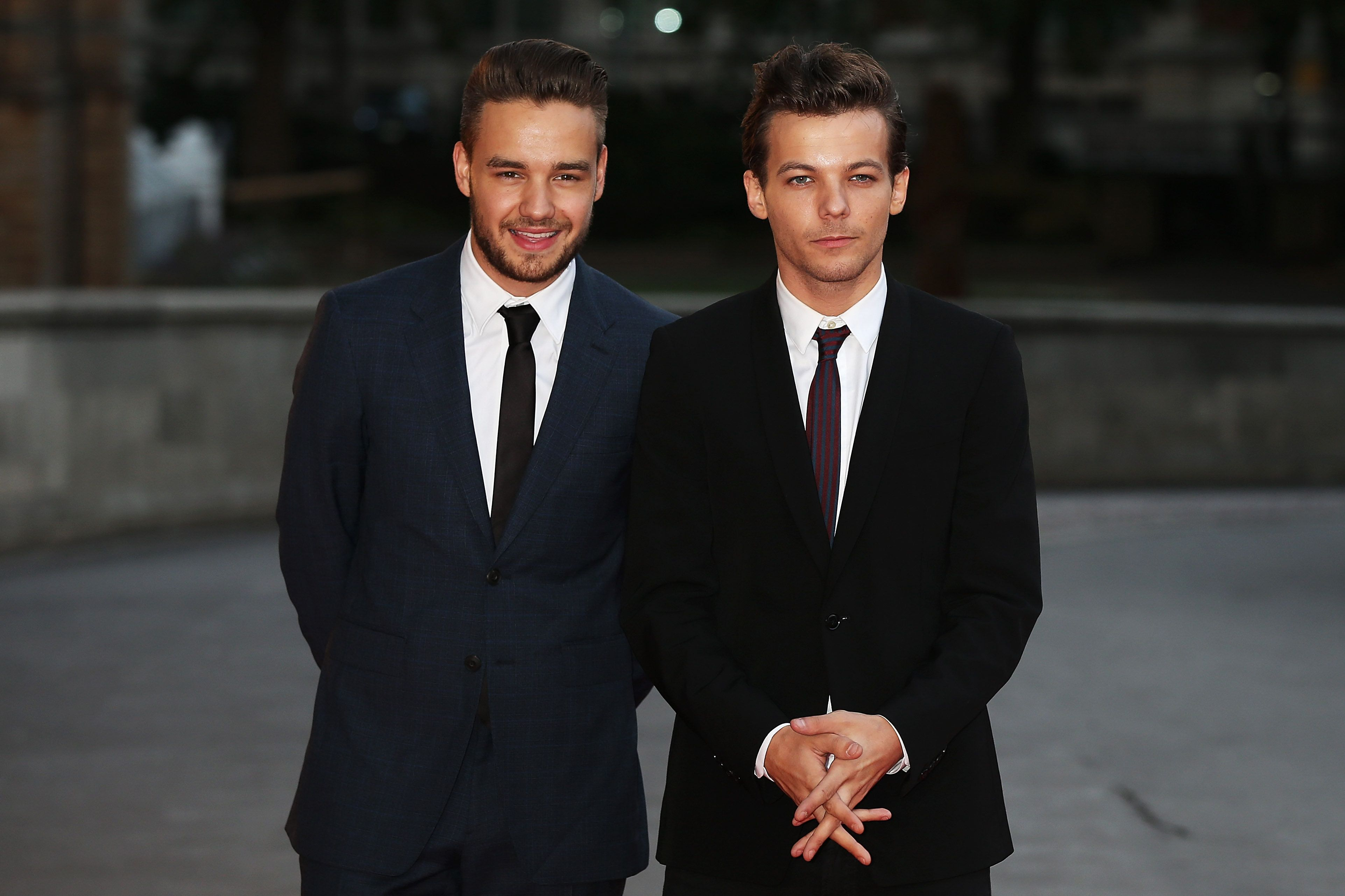LONDON, ENGLAND - AUGUST 10:  (SUN NEWSPAPER OUT. MANDATORY CREDIT PHOTO BY DAVE J. HOGAN GETTY IMAGES REQUIRED) Louis Tomlinson (R) and Liam Payne attend the Believe in Magic Cinderella Ball at the Natural History Museum on August 10, 2015 in London, England.  (Photo by Dave J Hogan/Getty Images)