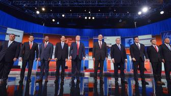 Republican presidential candidates arrive on stage for the Republican presidential debate on August 6, 2015 at the Quicken Loans Arena in Cleveland, Ohio. From left are:  New Jersey Gov. Chris Christie;  Florida Sen. Marco Rubio;  retired neurosurgeon Ben Carson; Wisconsin Gov. Scott Walker; real estate magnate Donald Trump; former Florida Gov. Jeb Bush; former Arkansas Gov. Mike Huckabee; Texas Sen. Ted Cruz; Kentucky Sen. Rand Paul; and Ohio Gov. John Kasich.  AFP PHOTO / MANDEL NGAN        (Photo credit should read MANDEL NGAN/AFP/Getty Images)