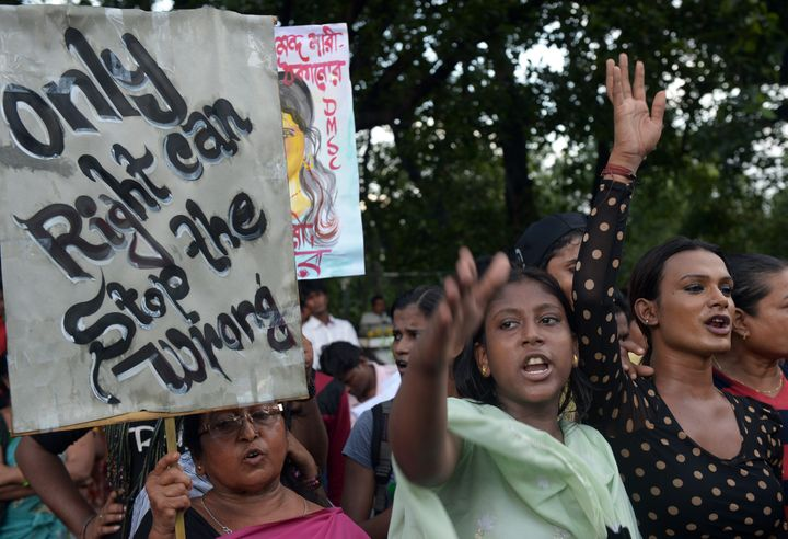 <p>Indian sex workers shout slogans as they participate in a rally in Kolkata on July 16, 2013. Amnesty International voted Tuesday to develop a policy on sex workers' rights.</p>