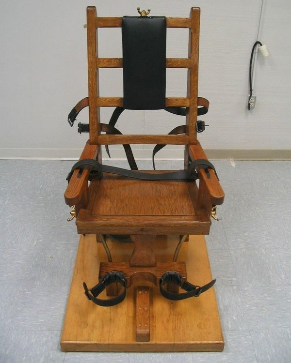 The first electric chair was used in 1890. Electrodes attached to an inmate's body deliver a current of electricity. Sometime