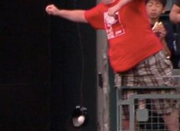 Two Fans Fail Miserably Trying To Use Hats To Catch Home Runs