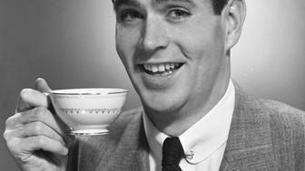 UNITED STATES - CIRCA 1950s:  Man drinking coffee.