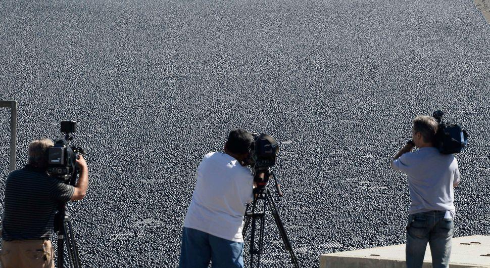 Camera crews capture the Los Angeles Reservoir's new look.