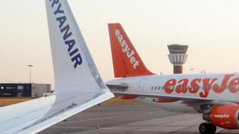 An Airbus in British low-cost airline EasyJet livery (R) and a Boeing in Ireland's low-cost carrier Ryanair are pictured on July 6, 2015 on the tarmac at the Lille-Lesquin airport, northern France.AFP PHOTO / DENIS CHARLET        (Photo credit should read DENIS CHARLET/AFP/Getty Images)