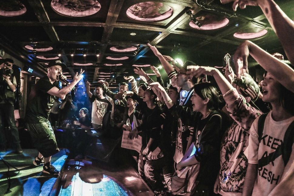 The rapper Fat Shady gets a crowd live in Kunming, China.