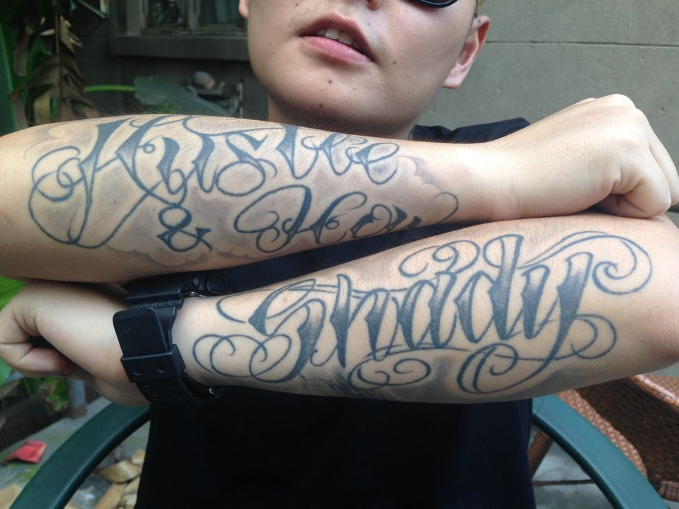 "English-language tattoos on Fat Shady's arms read ""Hustle & Flow"" and ""Shady."""