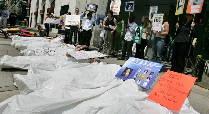 <p>Protestors demonstrate outside of Washington's Union Station against the killings of union organizers in Colombia.</p>