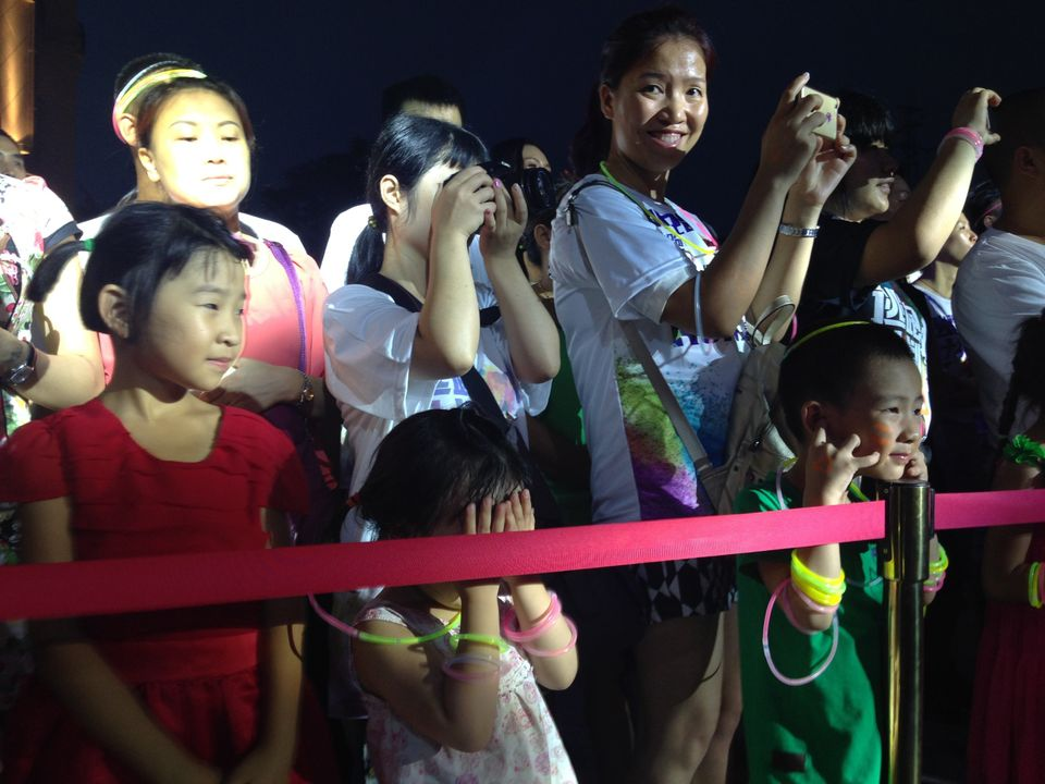 Fans of Fat Shady gather at a show marking the opening of the Golden Paris real estate development in Luzhou.