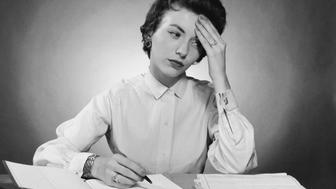 Businesswoman writing in a notebook in an office
