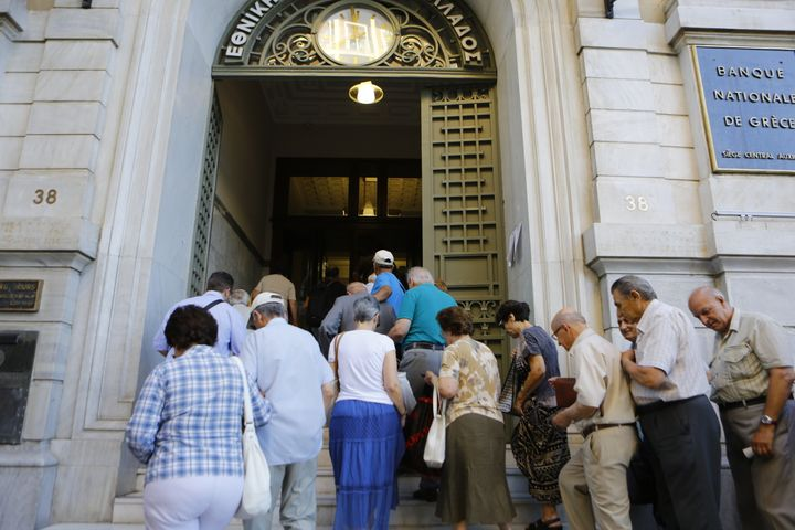The line outside an auxiliary branch of the Bank of Greece in Athens after capital controls were lifted.