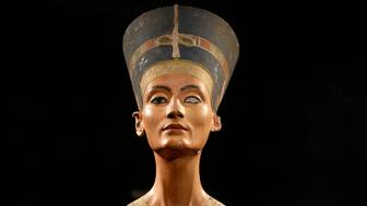 The Nefertiti bust is pictured during a press preview of the exhibition 'In The Light Of Amarna' at the Neues Museum (New Museum) in Berlin, Germany, Wednesday, Dec. 5, 2012 due to the 100th Anniversay of the discovery of the bust of the Nefertiti. (AP Photo/Michael Sohn, pool)