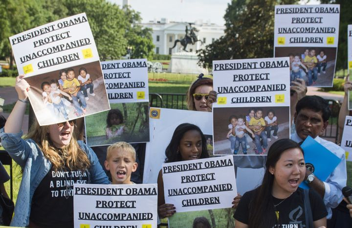 <span>Demonstrators with Amnesty International and We Belong Together protest during a rally in Washington, D.C., on July 17,
