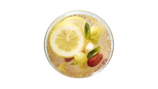 Fresh grapes and pear; a mixture of grapefruit, passion fruit, lemon and lime juices; plus club soda and ginger ale come toge