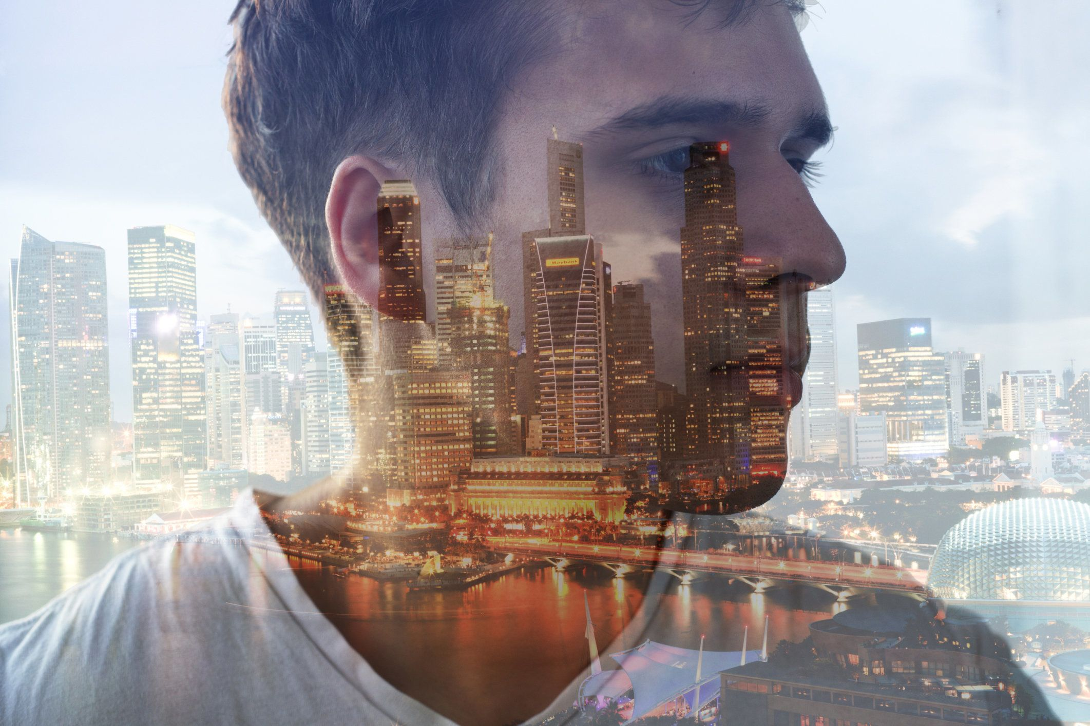 composite image of man's head and night time cityscape