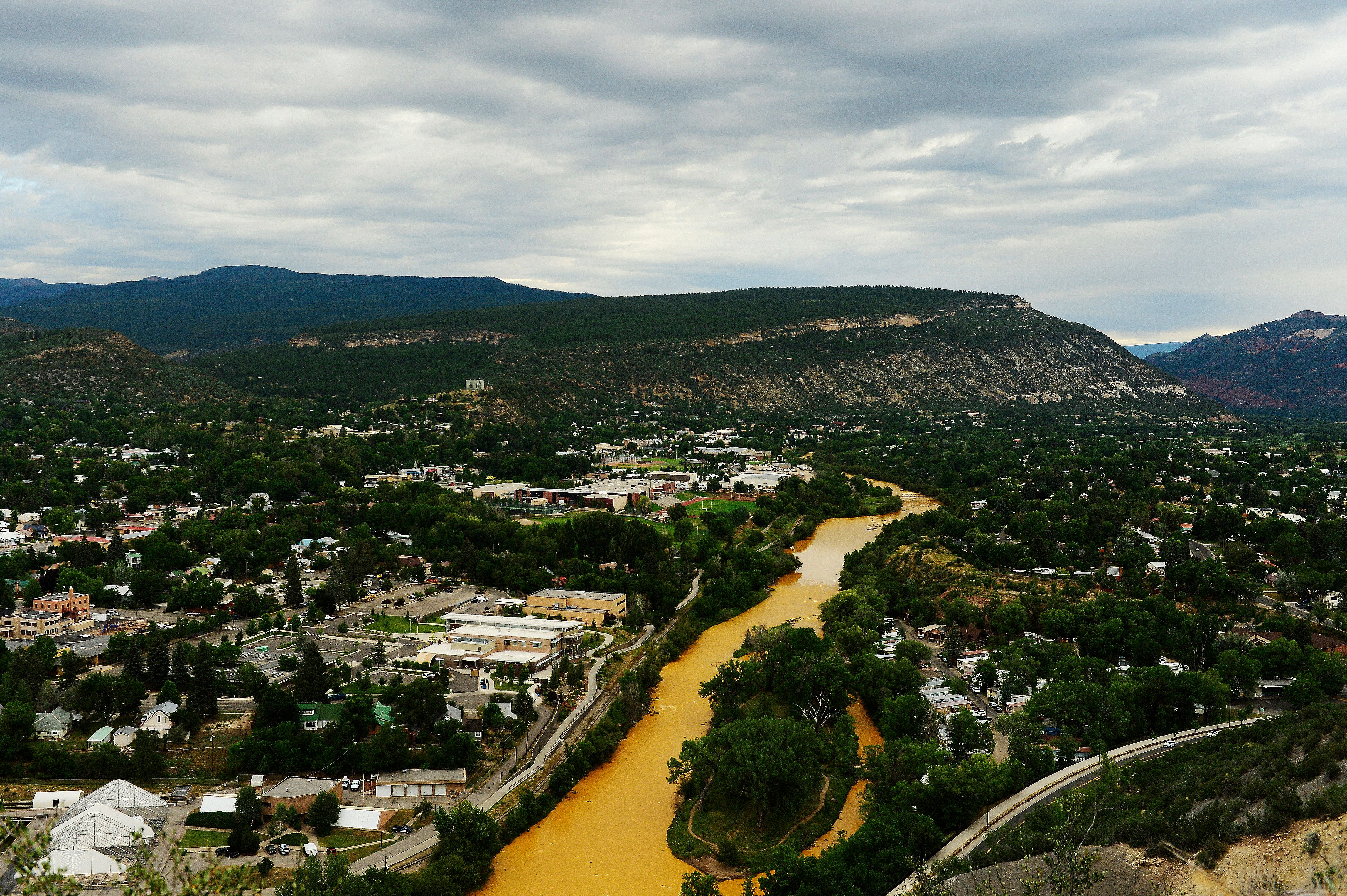 DURANGO, CO - AUGUST 7: The Animas River flows through the center of Durango on August 7, 2015 along Animas River. Over a million gallons of mine wastewater has made it's way into the Animas River closing the river and put the city of Durango on alert. (Photo By Brent Lewis/The Denver Post via Getty Images)