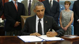 US President Barack Obama signs the Sawtooth National Recreation Area and Jerry Peak Wilderness Additions Act in the Oval Office at the White House in Washington on August 7, 2015. The act designates specified parcels of federal land in central Idaho as wilderness areas and as components of the National Wilderness Preservation System. AFP PHOTO/YURI GRIPAS        (Photo credit should read YURI GRIPAS/AFP/Getty Images)