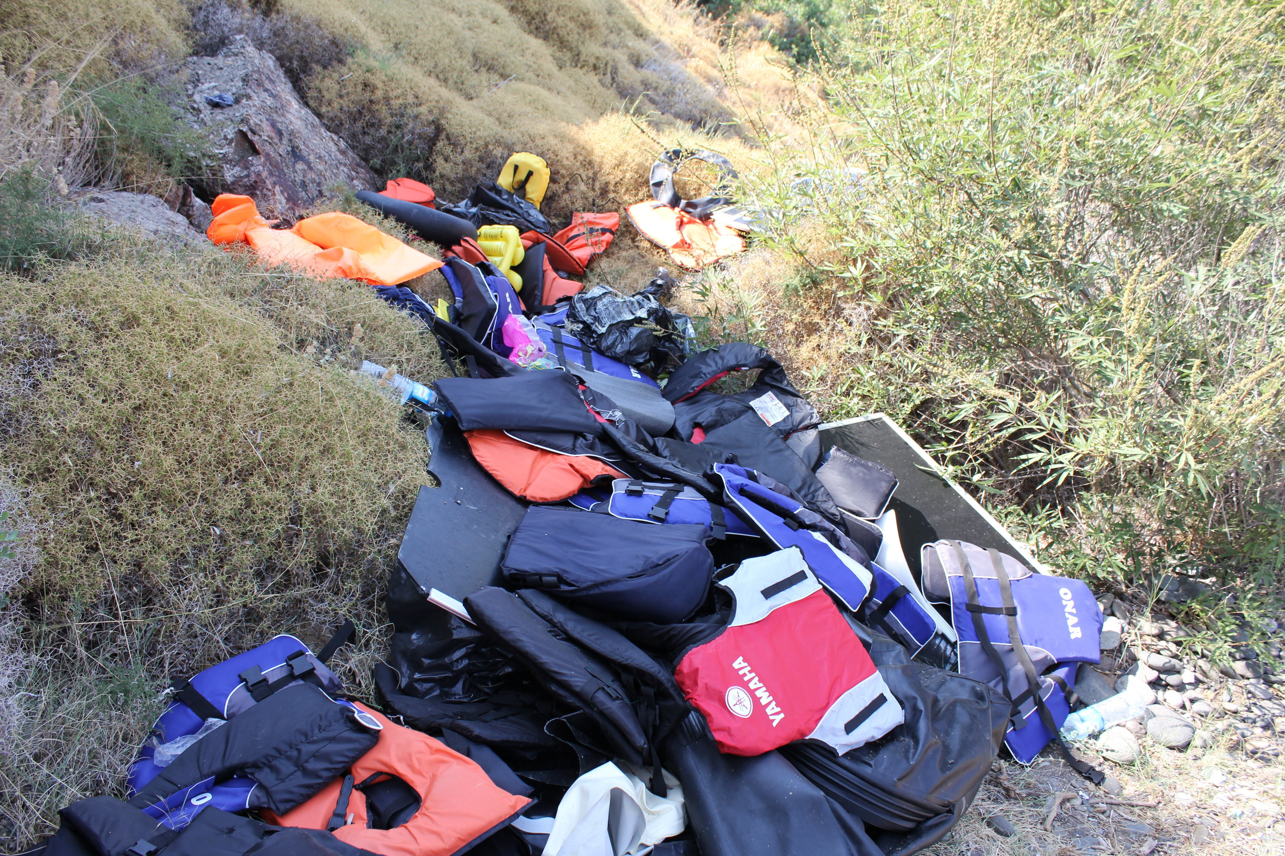 Life jackets used by Syrian refugees who made the dangerous dinghy trip from Turkey are thrown out near the port of Molyvos o