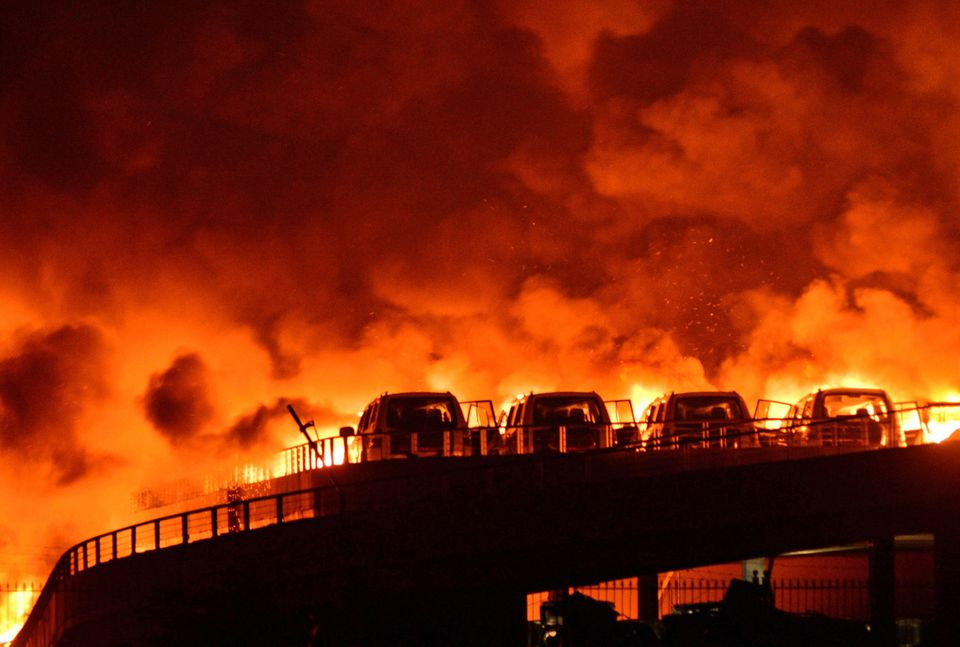 Fire and smoke were seen after explosions at a warehouse in Binhai New Area on Aug. 13, 2015, in Tianjin, China.