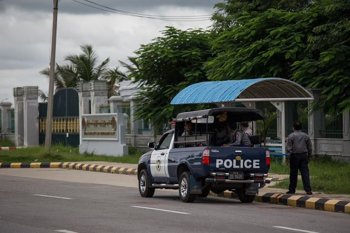 Police wait outside the USDP headquarters in Naypyitaw, Burma, on Aug. 13, 2015.