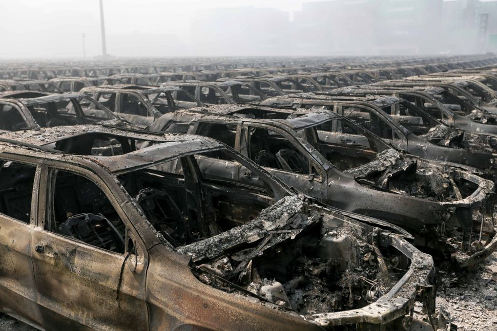 Brand new cars parked in Tianjin port that were badly damaged by the explosions, Aug. 13, 2015.