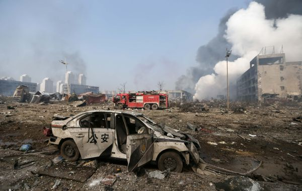 A damaged police car is seen at the site of the massive explosions in Tianjin on Aug. 13, 2015.