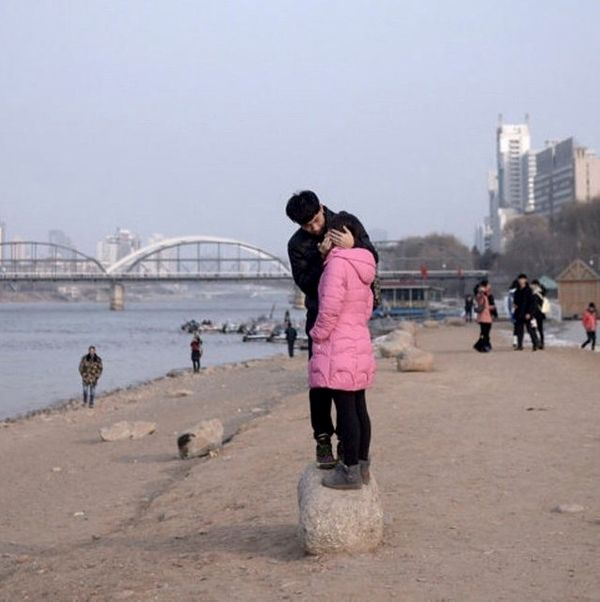A couple embraces by the Yellow River in Lanzhou, Gansu, China.