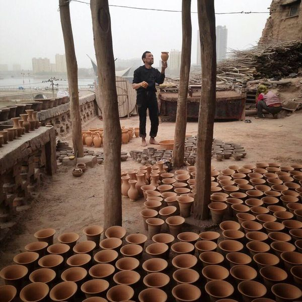 A potter works in the old city of Kashgar, Xinjiang.