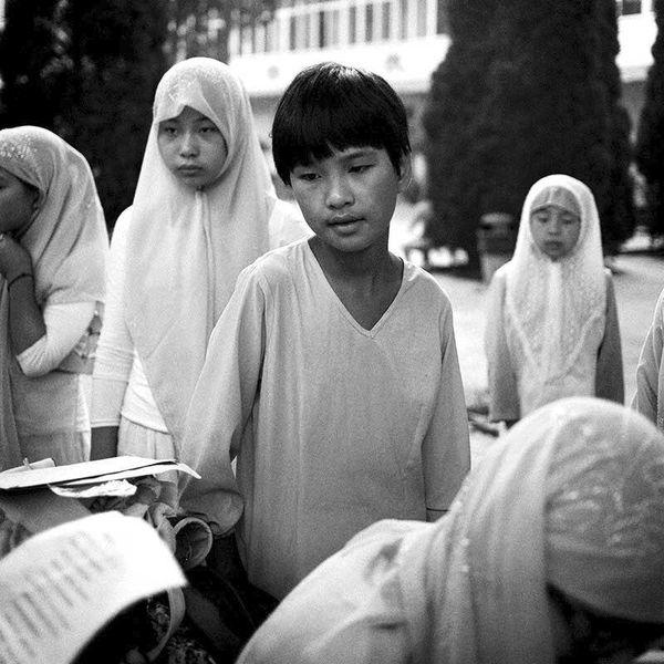 Young Hui Muslim children prepare for morning prayers at the Qingzhen Nansi mosque in Changzhi, Shangxi Province.