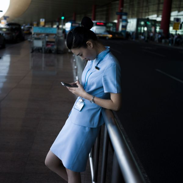 A flight attendant takes a break at the Beijing airport on July 3, 2015.