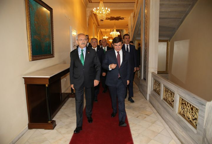 Turkish Prime Minister and leader of AKP Ahmet Davutoglu, right, and CHP leader Kemal Kilicdaroglu walk together at the Ankar
