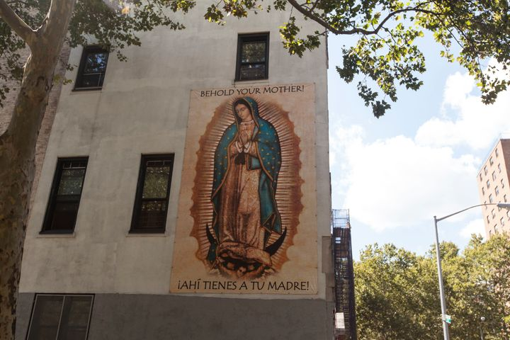 An image of Mary is posted on one of the walls of the Our Lady Queen of Angels complex.