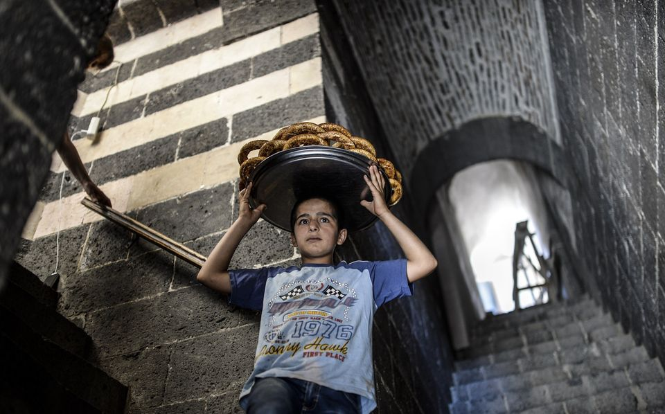 A boy sells bread in the historical Hasanpasa courtyard in Diyarbakir, Turkey, on June 8, 2015.