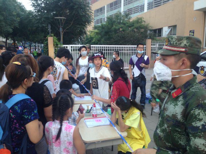 Volunteers work in Tianjin in the aftermath of massive explosions.