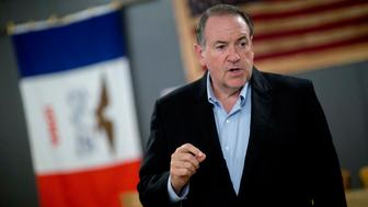 Mike Huckabee, former governor of Arkansas and 2016 Republican presidential candidate, speaks to attendees during a campaign stop at Northside Cafe in Winterset, Iowa, U.S., on Wednesday, Aug. 12, 2015. Huckabee will speak at the Iowa State Fair's political soapbox tomorrow. Photographer: Andrew Harrer/Bloomberg via Getty Images