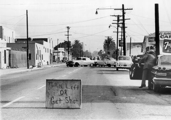 UNITED STATES - APRIL 22:  Approach A Ghetto Black In The South Central Los Angeles, a sign indicated ': Turn Left If You Wan