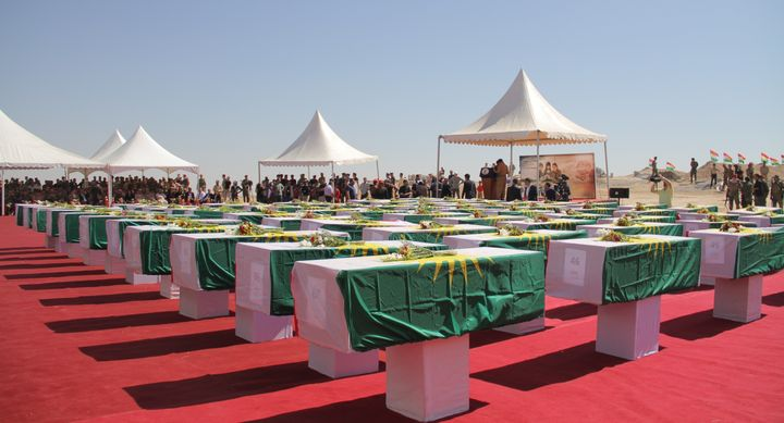 The funeral ceremony of 67 Yazidis, who were killed by ISIS militants and buried in mass graves, in Nineveh, Iraq, on Au