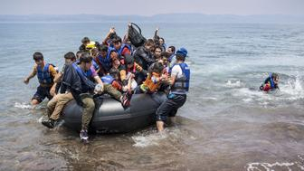 <p>Refugees arrive on the shores of the Greek island of Lesbos on June 2, 2015.</p>