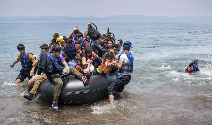 Refugees arrive on the shores of the Greek island of Lesbos on June 2, 2015.