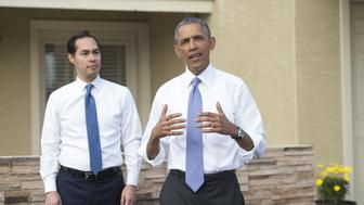 US President Barack Obama speaks alongside Housing and Urban Development Secretary Julian Castro (L), during a neighborhood stop to highlight his administration's home purchase and refinancing policies in Phoenix, Arizona, January 8, 2015. AFP PHOTO / SAUL LOEB        (Photo credit should read SAUL LOEB/AFP/Getty Images)