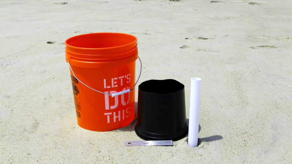 Adams forgoes the traditional pail and shovel for bigger and more basic tools such as a paint bucket, cylinders with both end
