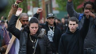 MADISON, WI - MAY 12:  Andrea Irwin (L), the mother of Tony Robinson, marches in the streets with family members and supporters after Dane County District Attorney Ismael Ozanne announced there would be no charges filed against Officer Matt Kenny in the shooting death of her 19-year-old son Tony on May 12, 2015 in Madison, Wisconsin. Robinson was killed March 6th after Kenny responded to a several calls claiming Robinson was acting disorderly and violent.  Kenny claims he was assaulted by Robinson and shot him in self defense.  (Photo by Scott Olson/Getty Images)